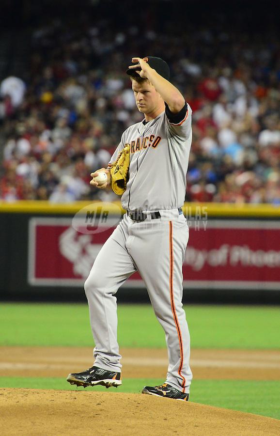 May 12, 2012; Phoenix, AZ, USA; San Francisco Giants pitcher Matt Cain reacts in the second inning against the Arizona Diamondbacks at Chase Field. Mandatory Credit: Mark J. Rebilas-