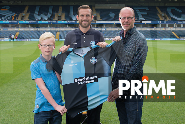 Paul Hayes of Wycombe Wanderers is handed his Home shirt by sponsors during Wycombe Wanderers Team Photoshoot 2015  at Adams Park, High Wycombe, England on 3 August 2015. Photo by PRiME Media Images.