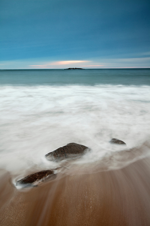 Rocks blend into the sea and sky on Sand Beach at Newport Cove in Acadia National Park, Maine, USA