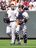 New York Yankees pitcher Andy Pettitte (46), left and catcher Jorge Posada (20), right, discuss strategy as they walk in from the bullpen prior to the game against the Baltimore Orioles at Oriole Park at Camden Yards in Baltimore, MD on Sunday, September 19, 2010..Credit: Ron Sachs / CNP.(RESTRICTION: NO New York or New Jersey Newspapers or newspapers within a 75 mile radius of New York City)