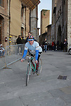 Old timer proudly rides his vintage Bianchi bike in San Gimignano at the sign on before the start of the 2014 Strade Bianche race over the white dusty gravel roads of Tuscany, Italy. 8th March 2014.<br /> Picture: Eoin Clarke www.newsfile.ie