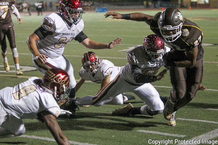 El Camino's Chris Brown, right, is pushed out of bounds Mission Hill's defense during the third quarter at El Camino High School Friday. photo by Bill Wechter