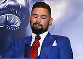 4th October 2017, Park Plaza, London, England; Tony Bellew versus David Haye, The Rematch, Press Conference; Tony Bellew smirking while David Haye explaining to the media how he will defeat Tony Bellew during the press conference