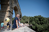 former Danish pro and former (tarnished) yellow jersey Michael Rasmussen (as commentator) at the stage start<br /> <br /> Stage 17: Pont du Gard to Gap (206km)<br /> 106th Tour de France 2019 (2.UWT)<br /> <br /> ©kramon