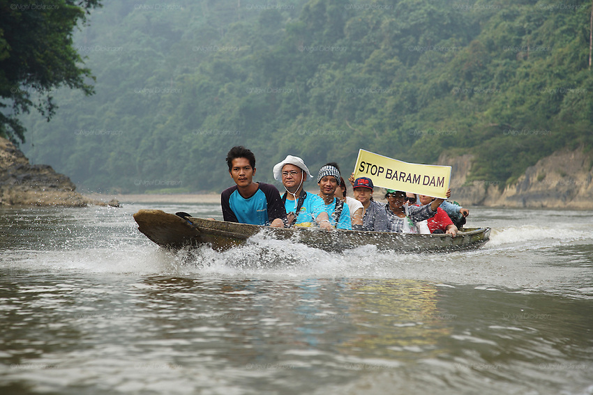 Blockades against the Baram Dam have been a huge success, after years of campaigning and protest, the  Baram Dam in Sarawak has now been shelved. Native leaders including Peter Kallang (white hat) from &quot;Save Rivers&quot; in longboat on Baram river. Baram Sarawak 2015<br />