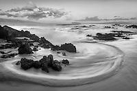 Wave pattern and sunrise clouds. Maui, Hawaii