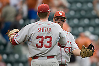 Third baseman Garrett Buechele #38 and Cameron Seitzer #33 of the Oklahoma Sooners hug after beating Texas Longhorns in NCAA Big XII baseball on May 1, 2011 at Disch Falk Field in Austin, Texas. (Photo by Andrew Woolley / Four Seam Images)