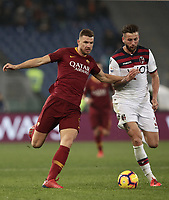 Football, Serie A: AS Roma - Bologna FC, Olympic stadium, Rome, February 18, 2019. <br /> Roma's Edin Dzeko (l) in action with Bologna's Mitchell Duks (r) during the Italian Serie A football match between AS Roma and Bologna FC at Olympic stadium in Rome, on February 18, 2019.<br /> UPDATE IMAGES PRESS/Isabella Bonotto