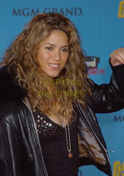 SHAKIRA.2005 Billboard Music Awards Arrivals held at the MGM Grand Hotel & Casino. Las Vegas, Nevada..USA, United States..6th December 2005.Ref:ADM/LF.half length black leather jacket fur trim collar plunging neckline cleavage.www.capitalpictures.com.sales@capitalpictures.com.© Capital Pictures.