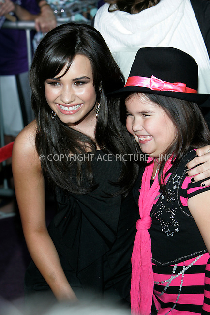 WWW.ACEPIXS.COM . . . . . ....February 24 2009, LA....Actress Demi Lovato and sister Madison De La Garz at the World Premiere of Walt Disney Pictures' 'Jonas Brothers: The 3D Concert Experience' on February 24, 2009 at the El Capitan Theatre in Hollywood, California.....Please byline: JOE WEST - ACEPIXS.COM....Ace Pictures, Inc:  ..(212) 243-8787 or (646) 679 0430..e-mail: picturedesk@acepixs.com..web: http://www.acepixs.com