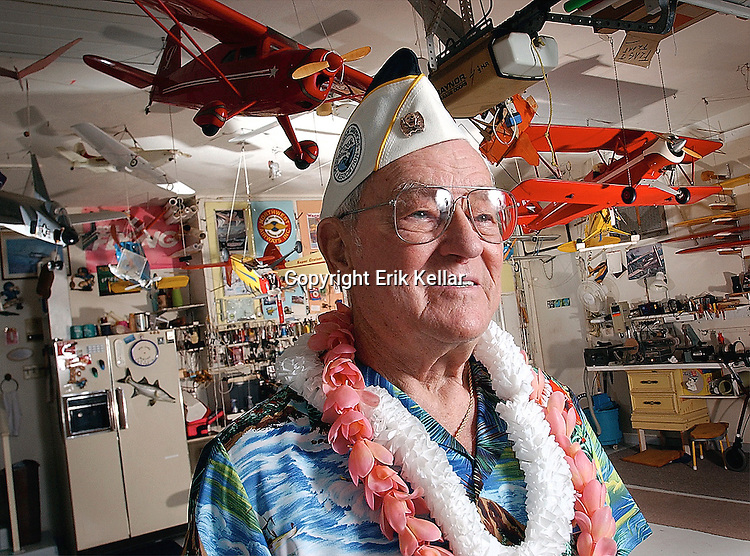 Elman Lemley, is a Pearl Harbor Veteran. I photographed Elman in 2002. Then he was on portable oxygen. When I first met him we walked through his garage in Royal Harbor and I noticed all the model airplanes he had hanging in there.  I sat with him and the reporter and when it came time to make  his photo I thought it would be nice to include this other side of him. Unconscious or not I think the planes adds to the story of him at Pearl Harbor. Thank you Elman.<br />