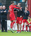Dundee's Luka Tankulic celebrates with Gary Harkins after he scores their third goal.