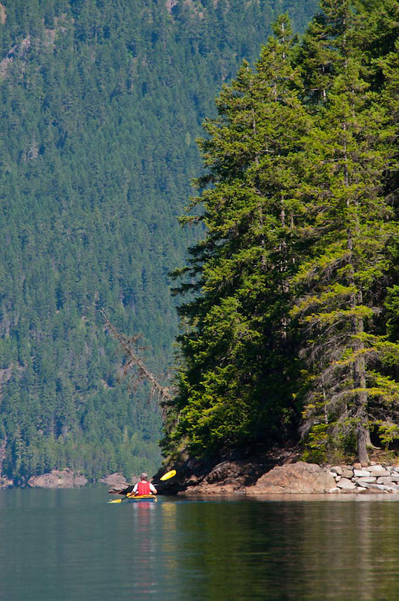 Joe Paddling on Ross Lake, Ross Lake National Recreation Area, North Cascades National Park, Washington, US