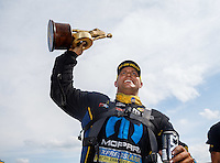 May 22, 2016; Topeka, KS, USA; NHRA funny car driver Matt Hagan celebrates after winning the Kansas Nationals at Heartland Park Topeka. Mandatory Credit: Mark J. Rebilas-USA TODAY Sports