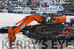 In Deep<br /> ----------<br /> Dredging work being carried out at the Dingle marina last Monday