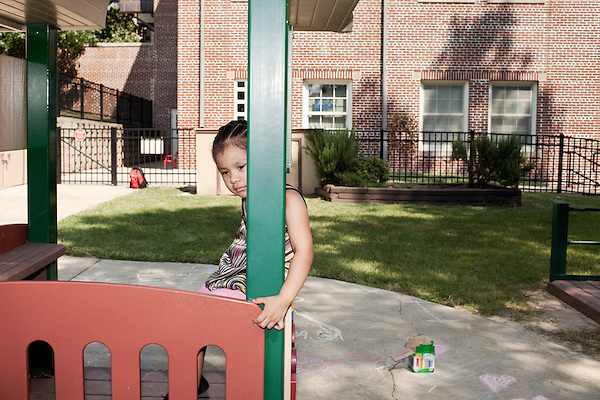 September 14, 2011. Raleigh, NC. . Melissa Valenzuela-Hilario sits on the playground during recess.. Project Enlightenment, a public pre-kindergarten program for at risk children, has been threatened with closure due to state wide budget cuts..