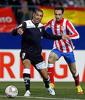 Atletico de Madrid's Juanfran (r) and Lazio's Andre Dias during Europa League match.February 23,2012. (ALTERPHOTOS/Acero) .Atletico Madrid Lazio Europa League.Italy Only