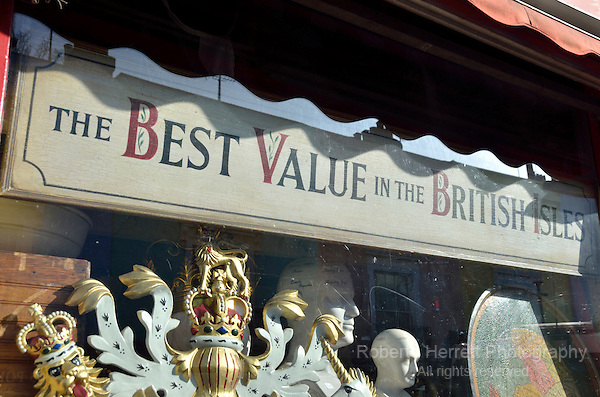 'The best value in the British Isles' sign in an antique shop window