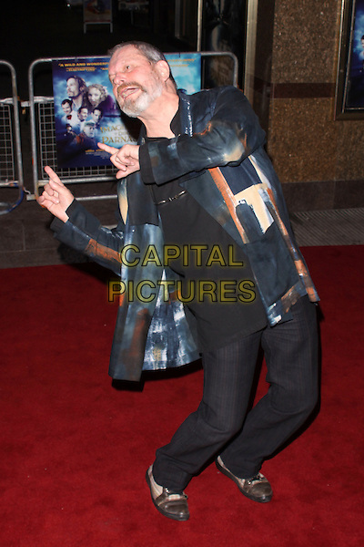 """TERRY GILLIAM.The UK Premiere of """"The Imaginarium Of Doctor Parnassus"""" at the Empire Leicester Square, London, England.  .October 6th, 2009 .full length director blue black print shiny jacket gesture shirt beard facial hair orange watercolour funny bending leaning.CAP/AH.©Adam Houghton/Capital Pictures."""