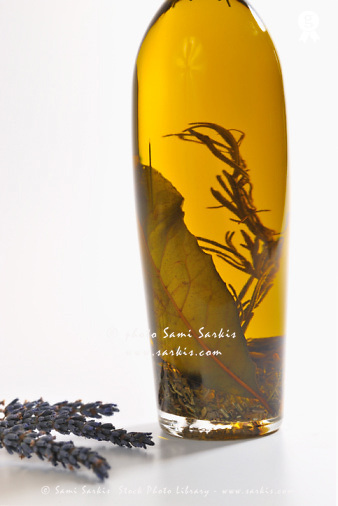 Bottle of herb-infused olive oil and lavender (Licence this image exclusively with Getty: http://www.gettyimages.com/detail/93187595 )