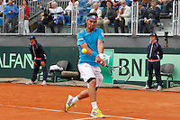 Fabio Fognini returns the ball  during  Davis Cup quarter-final tennis match against James Ward in Naples April 4, 2014.