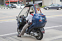 This Adiva scooter has a modular protection system to protect the driver from the elements. The top can be folded down.