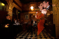 Dancers perform polished tangos at Bar Sur, a venerable club in the Buenos Aires historic district of San Telmo.