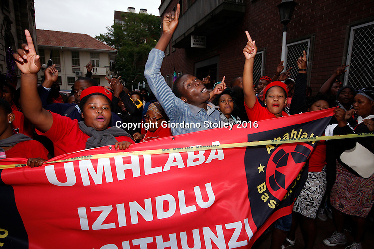 DURBAN - 20 May 2016 - Members of Abahlali baseMjondolo, an organisation of informal housing residents, protest outside the Durban High Court ahead of judgement and sentencing of two African National Congress Councillors --  Mduduzi Ngcobo, and Velile Lutsheko -- as well as the gunman they hired, for killing one of their members, Thulisile Maureen Ndlovu. The two eThekwini Metro Municipal councillors wanted her dead because she opposed their programme of allocating houses to people who were not resident in the Thkoza area of the KwaNdengezi near Pinetown. Picture: Allied Picture Press/APP