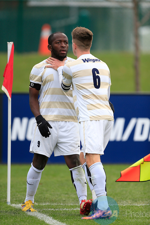 KANSAS CITY, MO - DECEMBER 03:  Askel Juul (6) of Wingate University calms down his teammate Elma N'for during the Division II Men's Soccer Championship held at Children's Mercy Victory Field at Swope Soccer Village on December 03, 2016 in Kansas City, Missouri. Wingate beat Charleston 2-0 to win the National Championship. (Photo by Jack Dempsey/NCAA Photos via Getty Images)