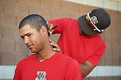 Batavia Muckdogs Pablo Garcia cuts the hair of teammate Aneury Osoria after a game against the Auburn Doubledays on September 5, 2016 at Dwyer Stadium in Batavia, New York.  Batavia defeated Auburn 4-3. (Mike Janes/Four Seam Images)