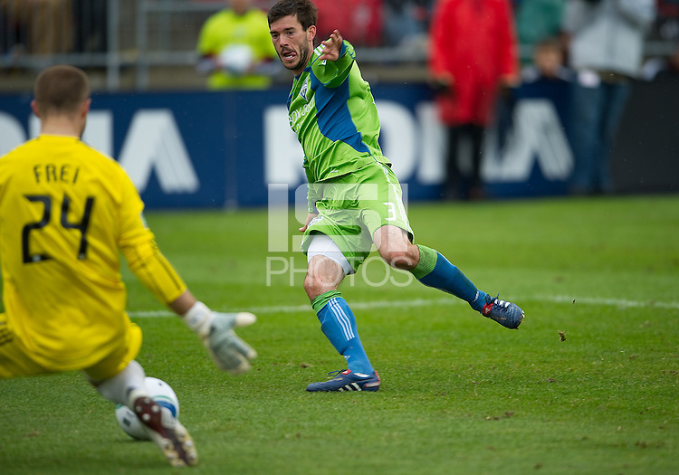 25 April 2010: Seattle Sounders midfielder Brad Evans #3 takes a shot on Toronto FC goalkeeper Stefan Frei #24 during a game between the Seattle Sounders and Toronto FC at BMO Field in Toronto..Toronto FC won 2-0....