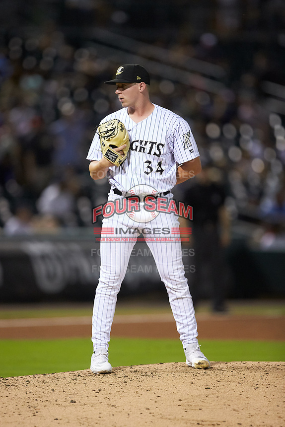 Charlotte Knights relief pitcher Hunter Schryver (34) looks to his catcher for the sign against the Scranton/Wilkes-Barre RailRiders at BB&T BallPark on August 14, 2019 in Charlotte, North Carolina. The Knights defeated the RailRiders 13-12 in ten innings. (Brian Westerholt/Four Seam Images)