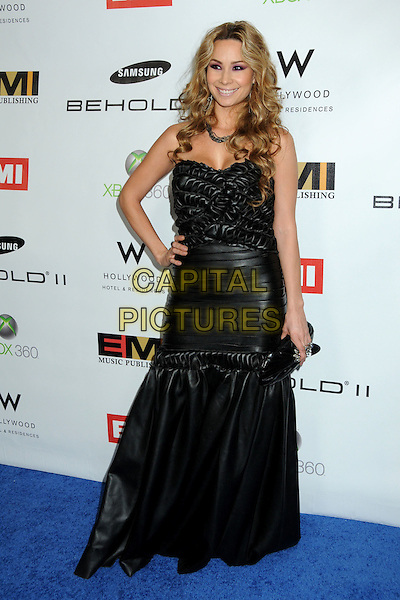 T LOPEZ .EMI Post Grammy Party 2010 held at the W Hollywood Hotel, Hollywood, California, USA, 31st January 2010..full length leather long maxi hand on hip ruched textured ribbed clutch bag strapless black dress grammys .CAP/ADM/BP.©Byron Purvis/Admedia/Capital Pictures