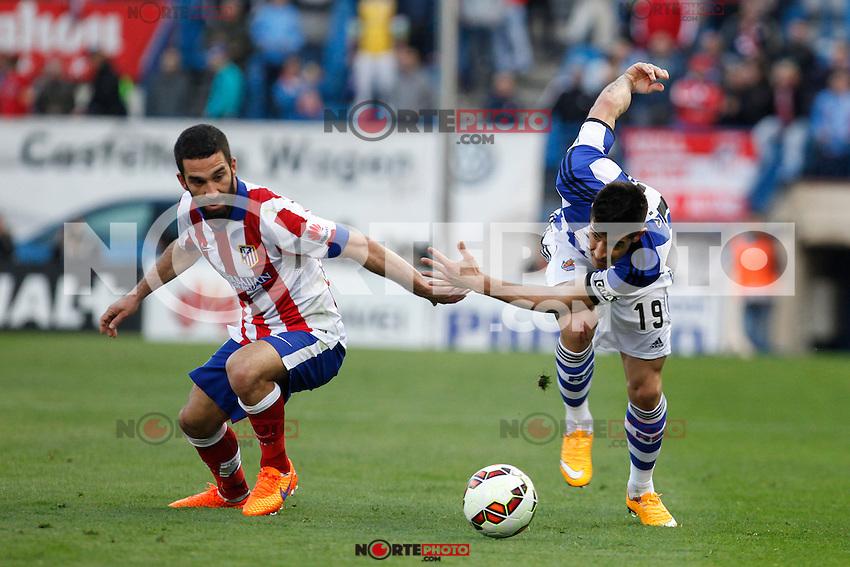Atletico de Madrid´s Arda Turan (L) and Real Sociedad´s Yuri during La Liga match at Vicente Calderon stadium in Madrid, Spain. April 07, 2015. (ALTERPHOTOS/Victor Blanco) /NORTEphoto.com