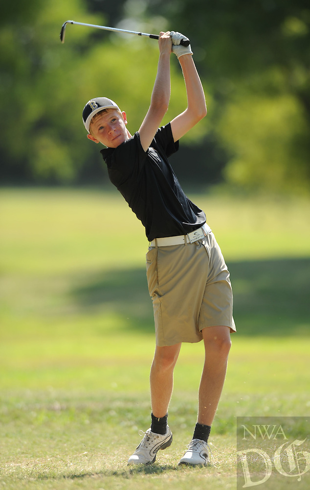STAFF PHOTO ANDY SHUPE - Bentonville's Tomas Mariscotti watches his tee shot on the seventh hole during a match Thursday, Aug. 21, 2014, at Razorback Golf Course in Fayetteville. Visit photos.nwaonline.com to see more photographs from the match.