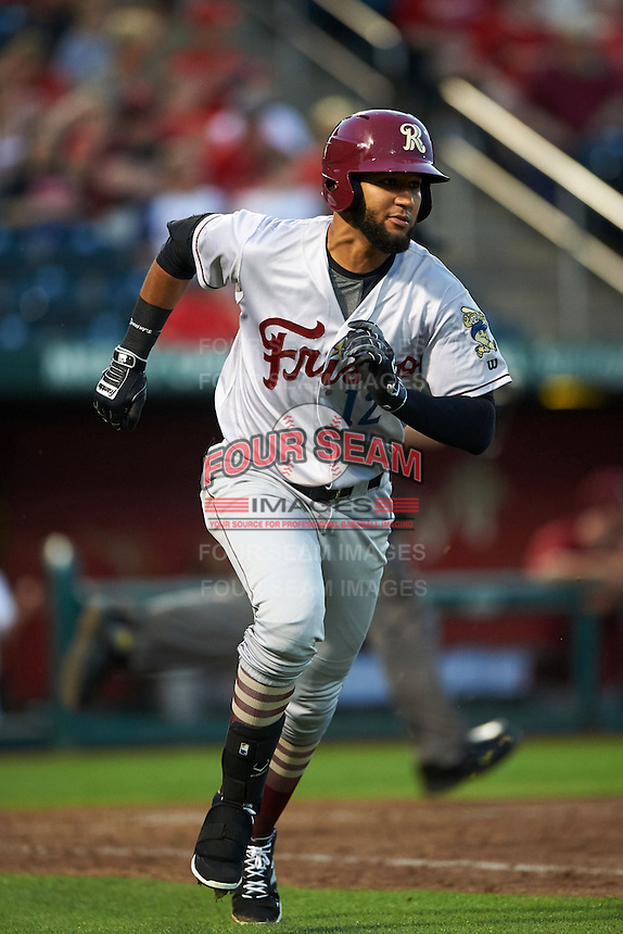 Frisco RoughRiders outfielder Nomar Mazara (12) runs to first during a game against the Springfield Cardinals  on June 4, 2015 at Hammons Field in Springfield, Missouri.  Frisco defeated Springfield 8-7.  (Mike Janes/Four Seam Images)