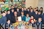 SLAN: Humphrey McMahon who retired as caretaker of Curow National School after 28 years surrounded by pupils on Thursday last. He was presented with a personalised clock by school principal Margaret Hanaffin.   Copyright Kerry's Eye 2008