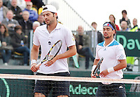 Italy's Simone Bolelli and Fabio Fognini  during their Davis Cup quarter-final doubles tennis match against Andy Murray Ross Hutchins in Naples April 5, 2014.