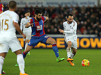 Leon Britton of Swansea (R) is challenged by Mile Jedinak of Crystal Palace during the Barclays Premier League match between Swansea City and Crystal Palace at the Liberty Stadium, Swansea on February 06 2016