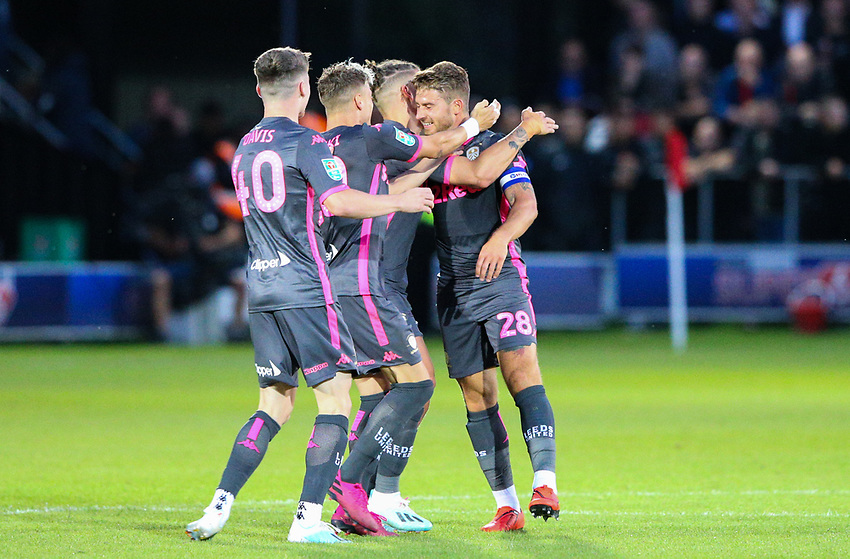Leeds United's Gaetano Berardi is mobbed by teammates after scoring his side's second goal<br /> <br /> Photographer Alex Dodd/CameraSport<br /> <br /> The Carabao Cup First Round - Salford City v Leeds United - Tuesday 13th August 2019 - Moor Lane - Salford<br />  <br /> World Copyright © 2019 CameraSport. All rights reserved. 43 Linden Ave. Countesthorpe. Leicester. England. LE8 5PG - Tel: +44 (0) 116 277 4147 - admin@camerasport.com - www.camerasport.com