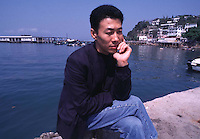080397: HONG KONG ; HAN DONG FAN:<br /> Labour activist and dissident, Han Dong Fan, relaxes on Lamma island, his home in hong Kong.  Han was forced into exile in the British colony after being refused entry to the mainland after returning from medical treatment in the USA several years ago.<br /> <br /> PHOTO BY RICHARD JONES/SINOPIX