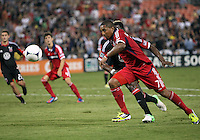 WASHINGTON, DC. - AUGUST 22, 2012:  Brandon McDonald (4) of DC United is beaten to the ball by  Sherjill McDonald (7) of the Chicago Fire during an MLS match at RFK Stadium, in Washington DC,  on August 22. United won 4-2.