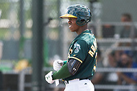 Oakland Athletics left fielder Lazaro Armenteros (13) stands on deck during an exhibition game against Team Italy at Lew Wolff Training Complex on October 3, 2018 in Mesa, Arizona. (Zachary Lucy/Four Seam Images)