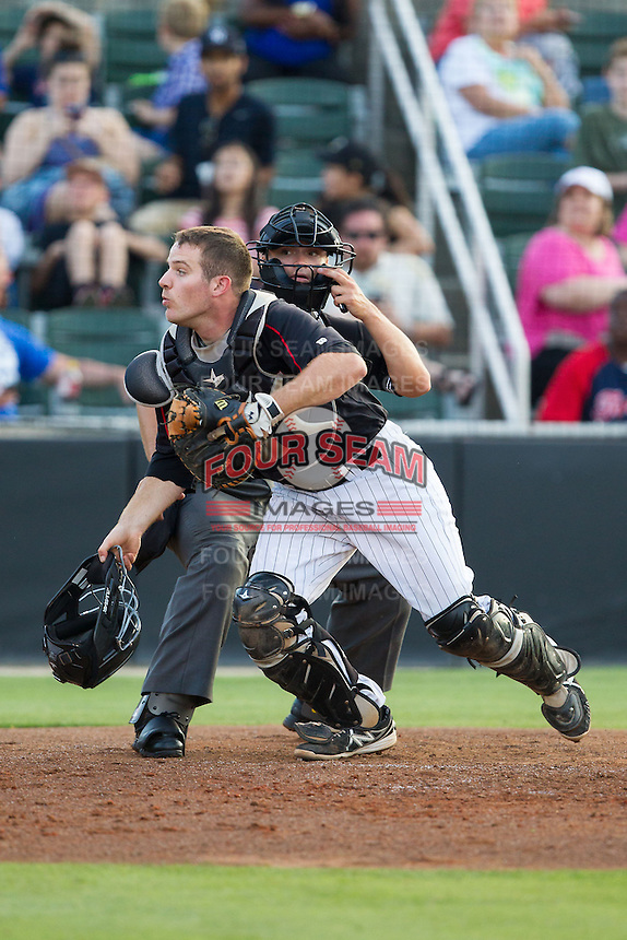 Kannapolis Intimidators catcher Jeremy Dowdy (25) chases after a pop fly behind home plate as umpire Tyler Ferguson looks on during the game against the Hagerstown Suns at CMC-Northeast Stadium on May 31, 2014 in Kannapolis, North Carolina.  The Intimidators defeated the Suns 4-3 in game two of a double-header.  (Brian Westerholt/Four Seam Images)