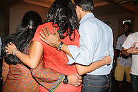 """Republican presidential candidate Bobby Jindal (right) and his wife Supriya Jolly Jindal (center) pose for a photo with a woman after his """"Believe Again"""" campaign event at the Governor's Inn and Restaurant in Rochester, New Hampshire. Jindal is campaigning in New Hampshire in advance of the 2016 Republican presidential primary there."""