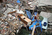Residents search for signs of trapped life on collapsed buildings in Beichuan, Sichuan, China. China now estimates the death toll to be around 50,000 as prospects of survival for those still buried diminishes..15 May 2008