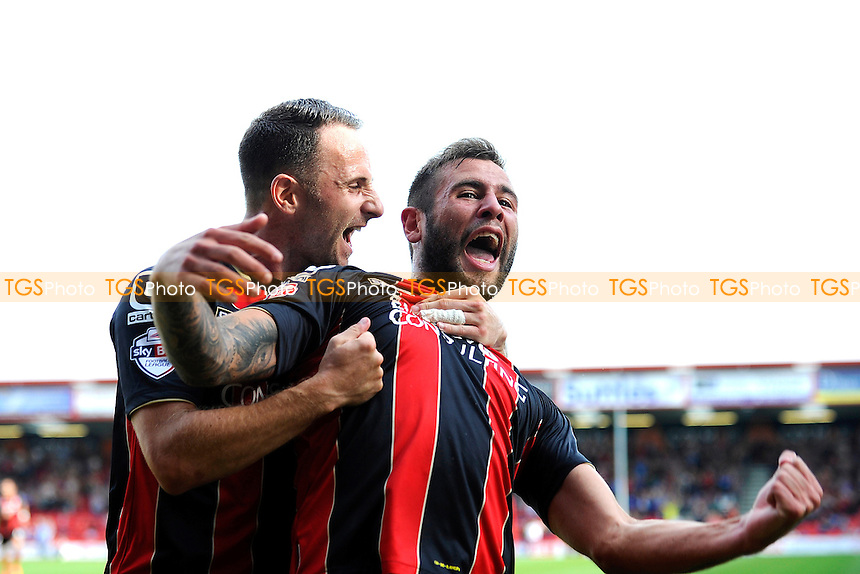 Marc Pugh of AFC Bournemouth congratulates Steve Cook of AFC Bournemouth right after scoring - AFC Bournemouth vs Rotherham United - Sky Bet Championship Football at the Goldsands Stadium, Kings Park, Boscombe, Bournemouth, Dorset - 13/09/14 - MANDATORY CREDIT: Denis Murphy/TGSPHOTO - Self billing applies where appropriate - contact@tgsphoto.co.uk - NO UNPAID USE