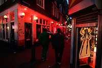 People at Red Light District in Amsterdam on 31 July, 2013. Amsterdam city council can continue with its policy of reducing the number of brothel owners in its red light district, the government's highest advisory body, said on Wednesday.The city council began cleaning up the red light district in 2008 and has now introduced new zoning laws which make it possible to evict brothel owners who are uncooperative.The aim is to reclaim one of the oldest and most picturesque parts of the city by encouraging exclusive shops to open there. ( Photo by Paulo Amorim/Sipa USA)