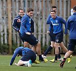Training antics as Kyle Hutton is about to take a tumble as Ross Perry crouches down in front of him as he runs backwards, the other players crack up as they know what is about to happen...