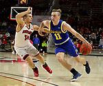 VERMILLION, SD - JANUARY 19: Noah Freidel #11 of South Dakota State Jackrabbits drives to the basket past Cody Kelley #10 of South Dakota Coyotes at the Sanford Coyote Center on January 19, 2020 in Vermillion, South Dakota. (Photo by Dave Eggen/Inertia)